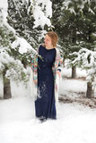 Happy woman in winter with snow. Looking blissful Royalty Free Stock Images