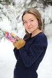 Happy woman in winter with snow Royalty Free Stock Photos
