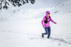 Happy woman winter trail running in beautiful inspirational land Royalty Free Stock Images
