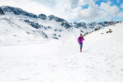 Happy woman winter trail running in beautiful inspirational land Royalty Free Stock Photography