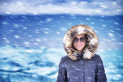 Happy woman on winter vacation Stock Photo
