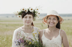 Happy woman wirh adult daughter. Happy mature women wirh adult daughter in summer field royalty free stock photos