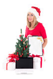 Happy woman with wish list, notebook,  christmas tree and gifts Stock Images