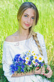 Happy woman wit bouquet of chamomiles and cornflowers Stock Images