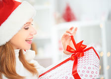 Happy Woman With Christma Gift At Home Royalty Free Stock Photography