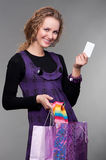 Happy Woman With Credit Card And Bags Royalty Free Stock Image