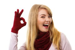Happy woman in woolen gloves showing sign ok, positive emotions Royalty Free Stock Images
