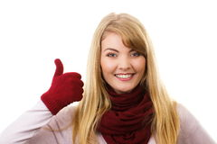 Happy woman in woolen gloves showing thumbs up, positive emotions Stock Image