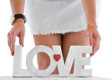Happy woman with word Love standing at home Stock Photo