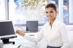 Happy woman working in bright office Royalty Free Stock Image