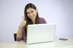 Happy woman working with computer thumb up Royalty Free Stock Images