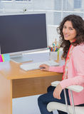 Happy woman working in creative office Stock Images