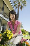 Happy Woman Working In Garden Royalty Free Stock Photos