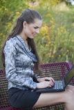 Happy woman working on laptop Stock Images
