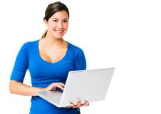 Happy woman working on laptop. Happy woman working on a laptop isolated over white Stock Image