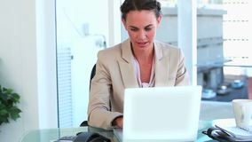 Happy woman working with laptop and picking up the phone Royalty Free Stock Image