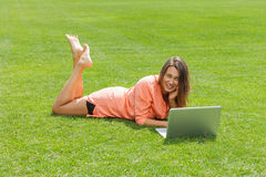 Happy woman working with laptop Stock Photography