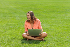 Happy woman working with laptop Royalty Free Stock Images