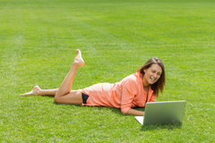 Happy woman working with laptop Stock Images