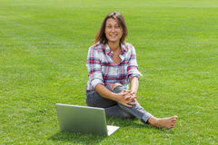 Happy woman working with laptop Royalty Free Stock Image