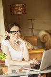 Happy woman working. Happy latin woman working in computer Stock Photography