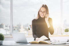 Happy woman working in office stock photo
