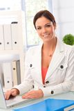 Happy woman working in office Royalty Free Stock Images