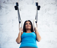 Happy woman working out on gimnastic rings Stock Photo