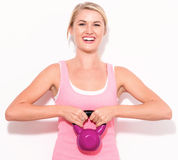 Happy woman working out with kettlebell Royalty Free Stock Photography