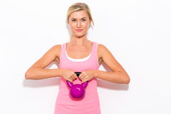 Happy woman working out with kettlebell Stock Photography