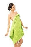 Happy woman wrapped in towel Stock Photo