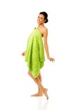 Happy woman wrapped in towel Royalty Free Stock Photo