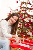 Happy woman wrapping Christmas present Royalty Free Stock Image
