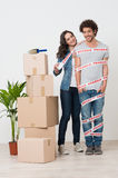 Happy Woman Wrapping Man With Sellotape Stock Image