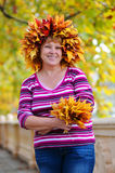 Happy woman in a wreath of leaves Stock Photography