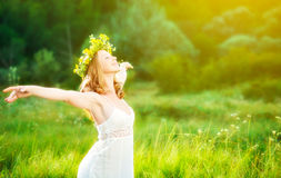 Happy woman in wreath summer enjoying life opening hands royalty free stock photography
