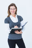 Happy woman writing in diary Stock Photography