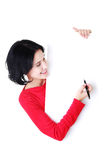 Happy woman writing with a pen on blank board. Royalty Free Stock Image