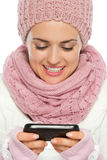 Happy woman writing text message Royalty Free Stock Image