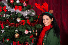 Happy Woman with Xmas tree Royalty Free Stock Photography