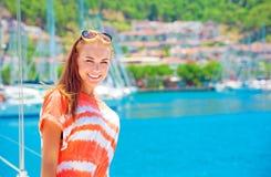 Happy woman at yacht port Stock Photo