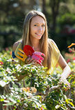 Happy woman in yard gardening Royalty Free Stock Images
