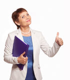 Happy woman 50 years old with a folder for documents. Attractive woman 50 years old with a folder for documents on white background Stock Images