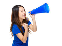 Happy woman yell with megaphone. Isolated on white background Stock Images
