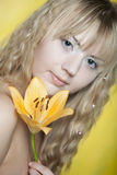 Happy woman with yellow flowers Stock Photos