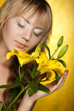 Happy woman with yellow flowers Royalty Free Stock Photo