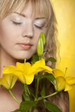 Happy woman with yellow flowers Stock Photography
