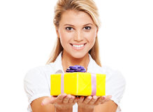 Happy woman with yellow gift Stock Image