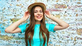 Happy woman with yellow hat. Stock Images