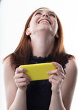 Happy woman with a yellow mobile phone Royalty Free Stock Images